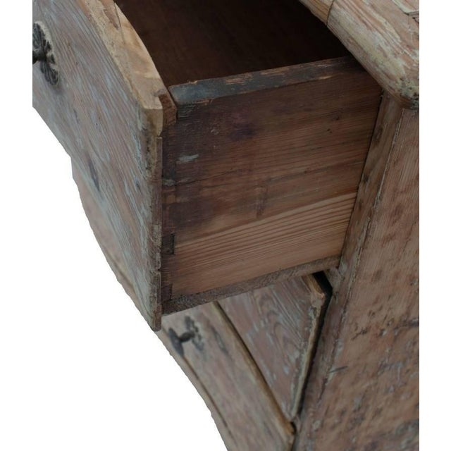 Stripped pine three-drawer commode restored to its natural color with heart shaped key holes.