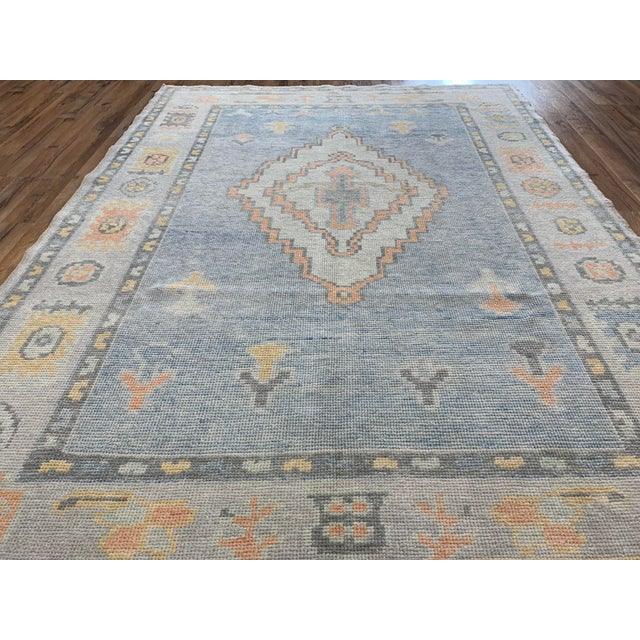This new Turkish rug has a beautiful diamond shaped center Medallion to make for a great statement piece for any room