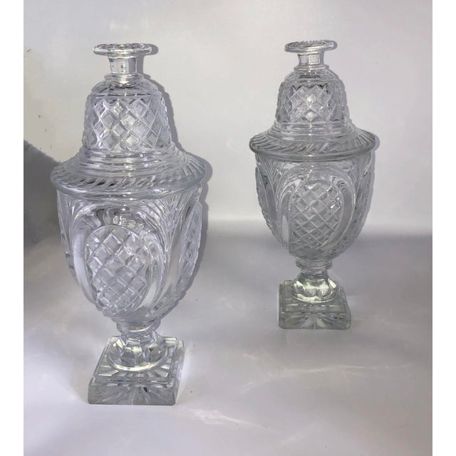 A vintage pair of 19th century crystal covered sweet meat urns from England.