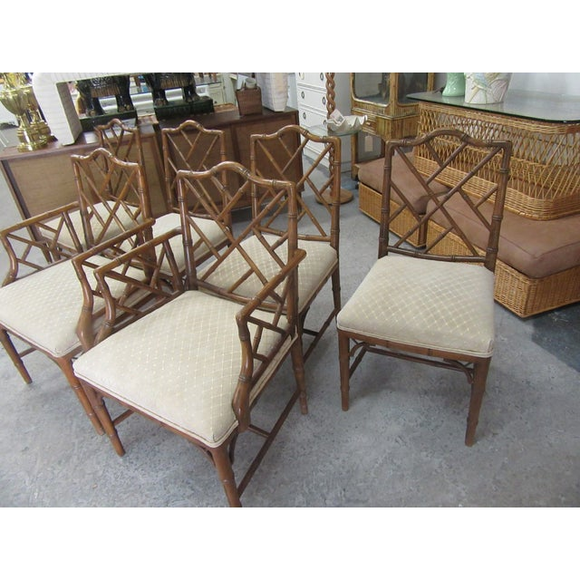 "Set of 6 Faux Bamboo Chippendale Chairs. Two arms and 4 sides. They measure 36"" H x 23"" W x 17""D. They seat is 16"" and the..."