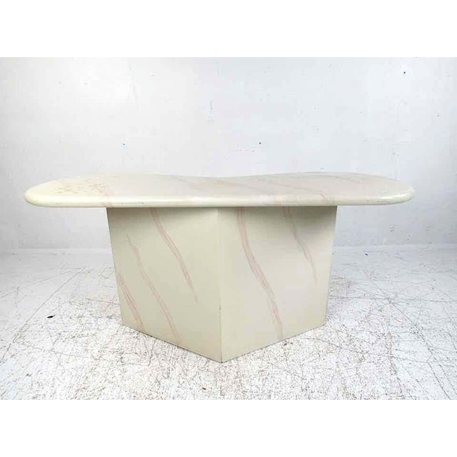 This lovely vintage modern hall table features an unusual freeform top. A sleek design that looks great in the entryway or...