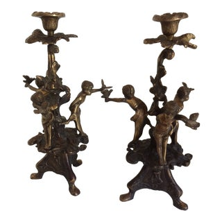 Pair of Italian Cast Bronze Cherub Candelabras For Sale