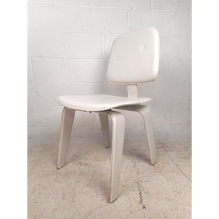 Set of Four Mid-Century Modern White Leather Dining Chairs Preview