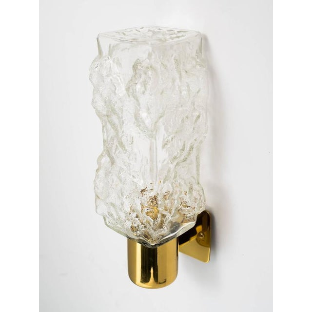 Stunning mid century sconces with Brutalist ice glass design. Sconces feature textured elongated glass cubes with modern...
