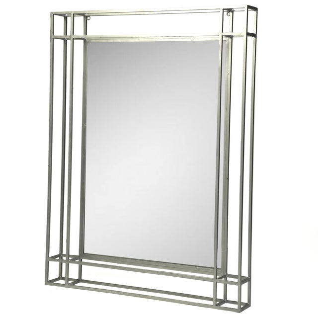 This mirror's simple, clean lines and silver-leaf finish make it an easy addition to a variety of interiors. May be hung...