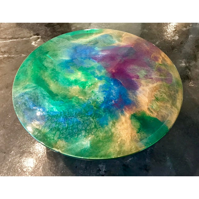 "Hand Painted one of a kind epoxy resin 36"" round coffee table with chrome base. Hand done by our own creative artistic..."