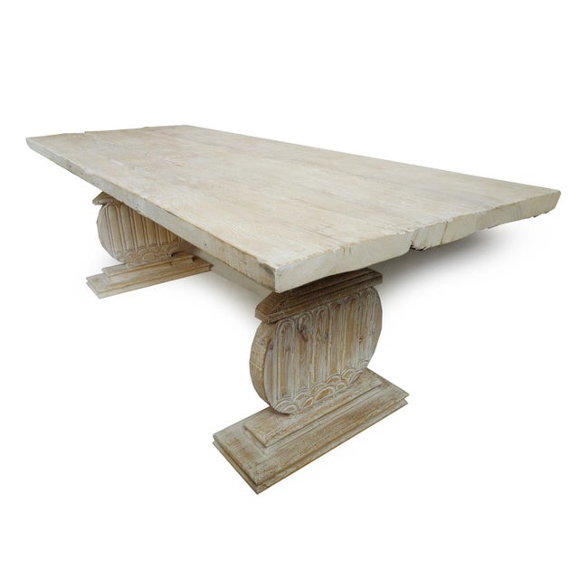 Rustic white wash dining table made from reclaimed pine wood. Beautiful hand carved pedestal base thats perfect for both...