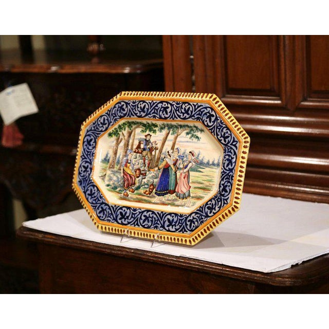 This large antique and colorful wall plate was created in Brittany, circa 1870. Hand painted in the blue and yellow...