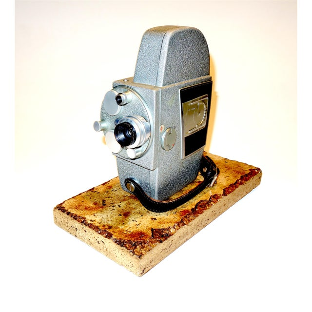 """Proposed for your approval is this Revere """"One Hundred Three"""" 16mm Portable Cinema Camera, Circa Mid 20th Century. A USA..."""