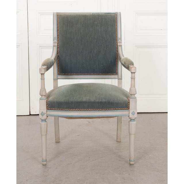 This delightful Second Empire carved and painted fauteuil, c. 1870, is from France. The frame is painted grey with pale...
