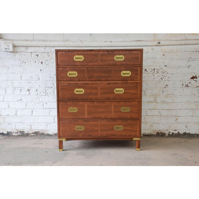 Offering a stunning newly refinish Baker Campaign highboy dresser. This dresser has beautiful polished brass pulls with...