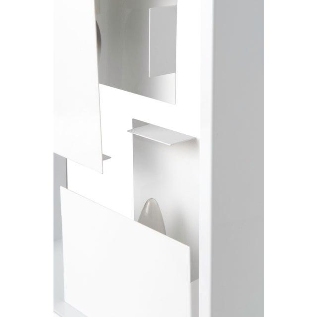"This Artemide ""Fato"" Table Lamp doubles as a light sculpture and makes a perfect conversation piece. Its unique placement..."