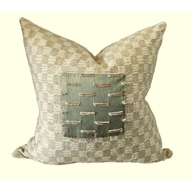 Two-toned beige nubby linen/cotton upholstery fabric is the perfect complement to the sage green silk center piece with...
