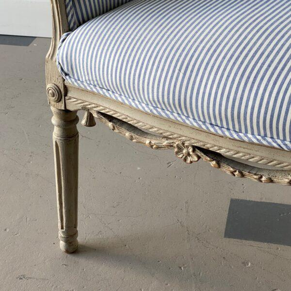 Swedish circa 1780 tub chair with carved detail and blue and white upholstery. Height: 32″ Width: 22.5″ Depth: 18″ SH: 18″