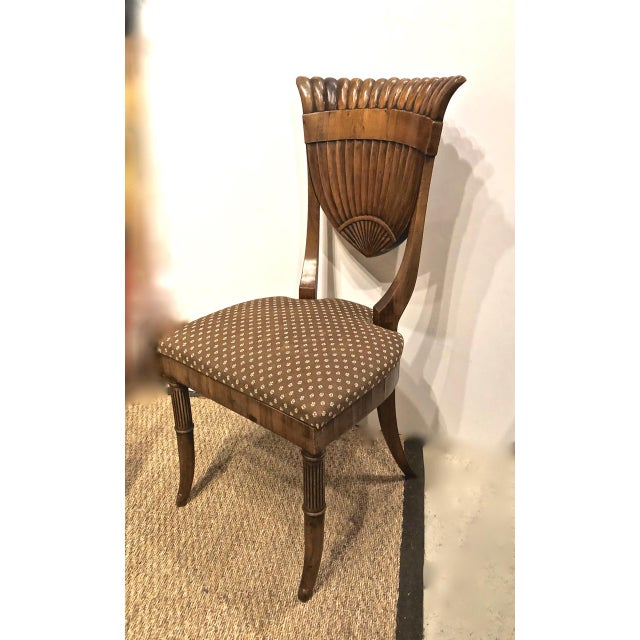 This is a beautifully executed Neoclassical-style walnut side chair. The chair dates to the first half of the twentieth...