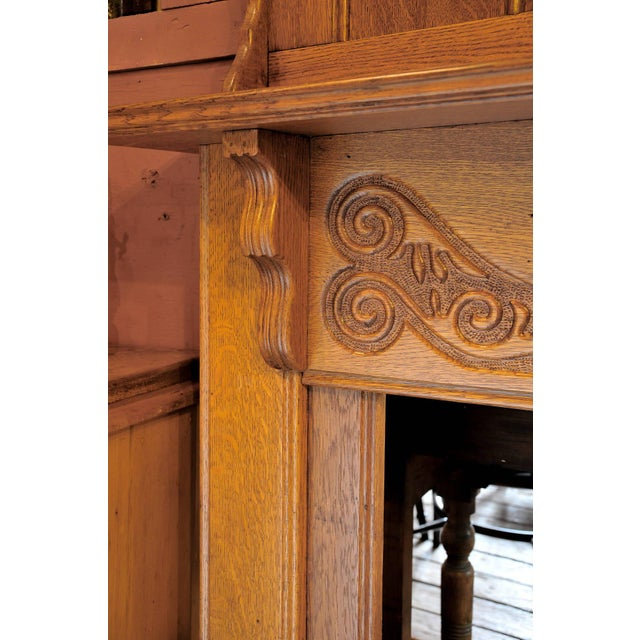 Oak carved mantel with a mirror and multiple shelves. Nice carving and color.