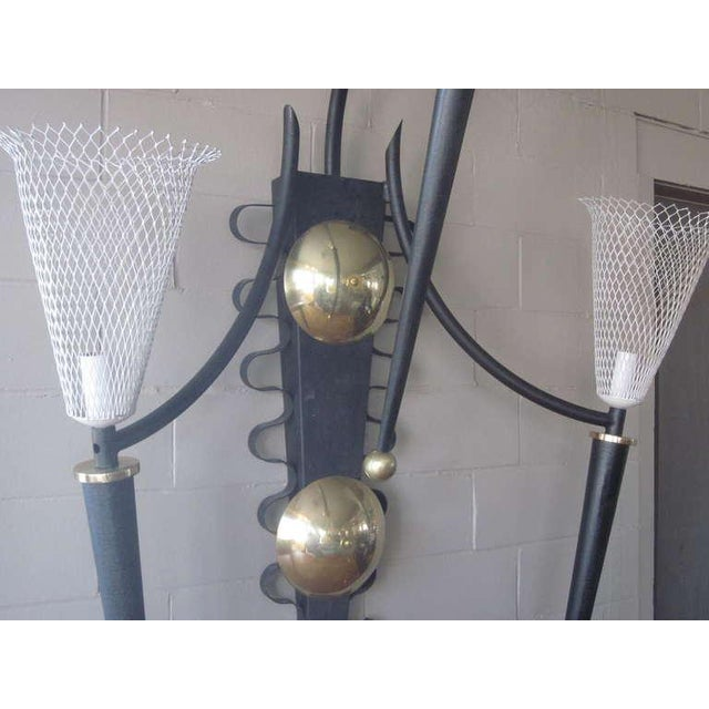 A large monumental theater sconce with wire basket shades in the style of Mathieu Mategot ,black metal horns and brass...