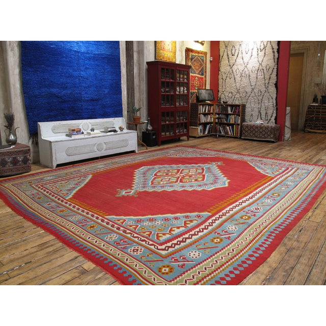 A large format antique kilim, woven in the Oushak region of Western Turkey, displaying the classic central medallion...
