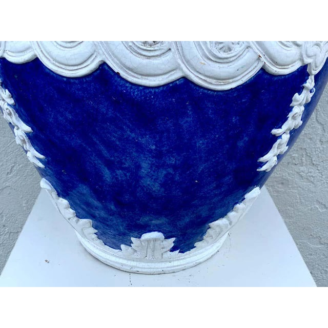 Italian blue and white Della Robbia style jardinière, Provenance, Celine Dion Of large scale the two handled urn with...