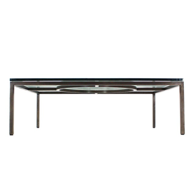 Massive heavy built mid century modern decorative coffee table with thick glass top. Heavy high quality craftsmanship...