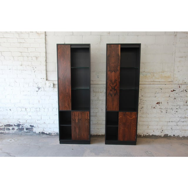 Offering an incredible pair of Harvey Probber cabinets with stunning rosewood and ebonized wood. Each cabinet has a unique...