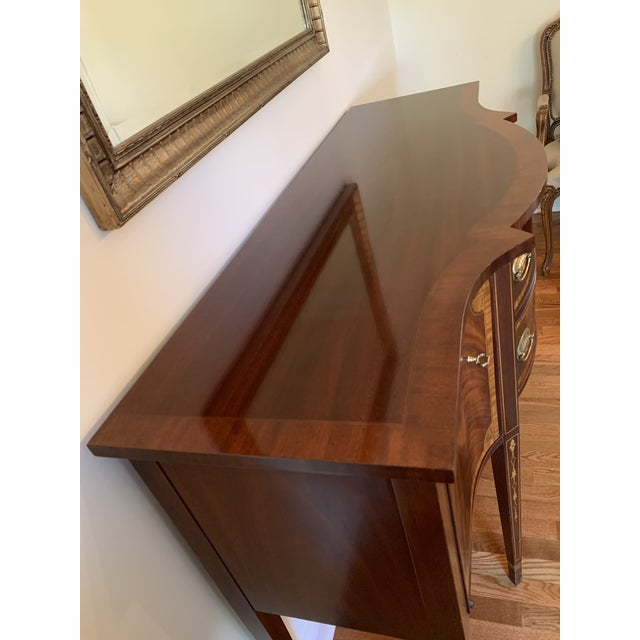 Mahogany Councill Craftsmen sideboard with two middle drawers for silver storage. Two locking side doors.