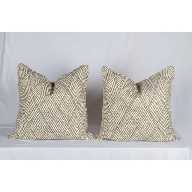Pair of custom beige-and-ivory cotton Tahitian stitch pattern pillows. Pattern on fronts and backs, self-welt. Hidden...