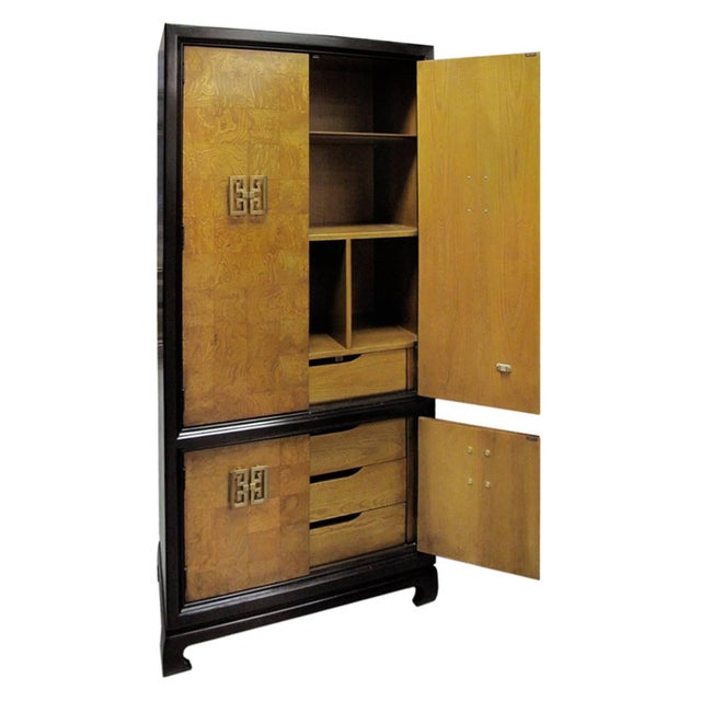 French tall chinoiserie style burl wood patchwork cabinet with Asian style brass pulls. If you would like to see this...