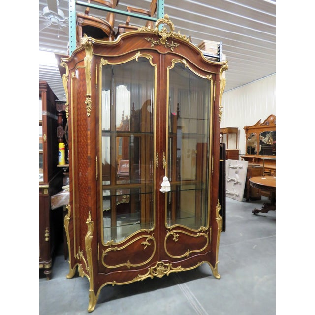 Monumental signed Francois Linke Louis XV style display cabinet. Intricate inlay with bronze mounts, and 3 glass shelves.