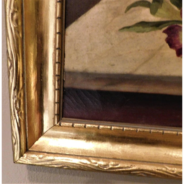 Stylized painting of beautiful pansies on a table in a room - beautifully painted - appears to have been re-framed in the...