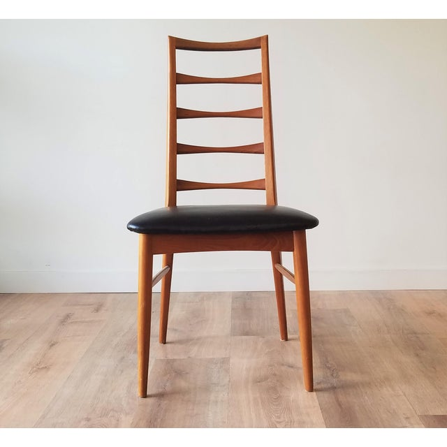 Fully restored and newly upholstered 'Lis' ladder back dining chairs by Niels Kofoed for Kofoeds Hornslet. The stunning...