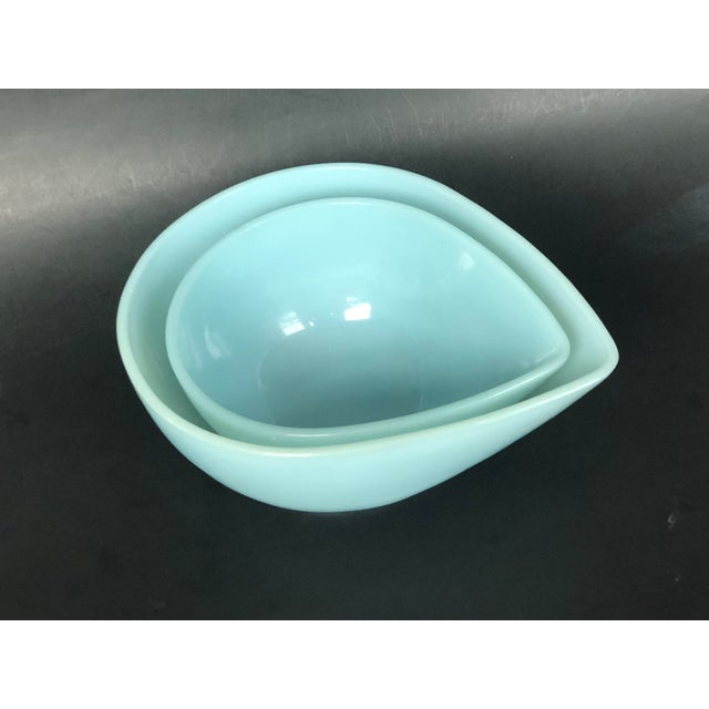 These mid-century modern blue glass teardrop nesting bowls are both decorative and practical for using as catch-alls on...