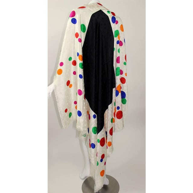 A beautiful and huge colorful vintage silk shawl from Saint Laurent. So many details of color, pattern and texture. Subtle...
