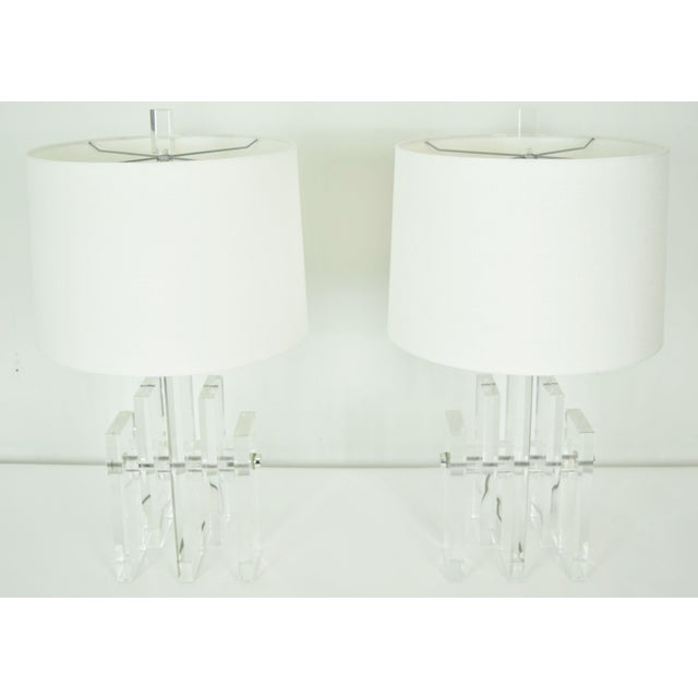 """Really nice pair of lucite """"skyscraper"""" lamps with chrome rod from which lucite is connected. Shades are not included."""