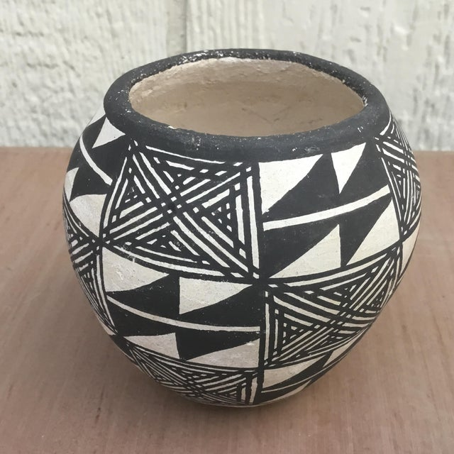 Emmalita Chino was inspired by her mother-in-law, Marie Z. Chino, to learn the art of pottery making. Marie taught...