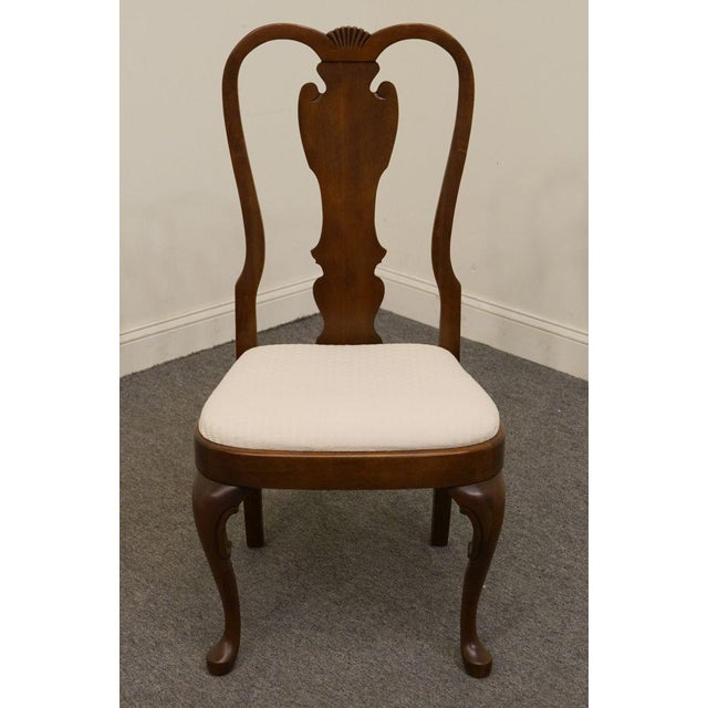 This is a vintage Pennsylvania House dining chair rendered in the Queen Anne style. The piece is made of cherry and is...