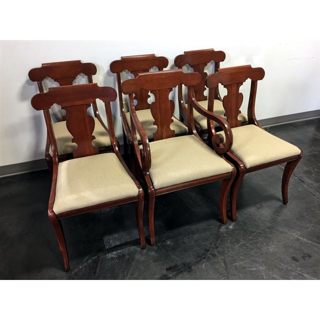 Here is a lovely set of six empire style dining chairs, made from solid cherry wood by top-quality furniture maker...