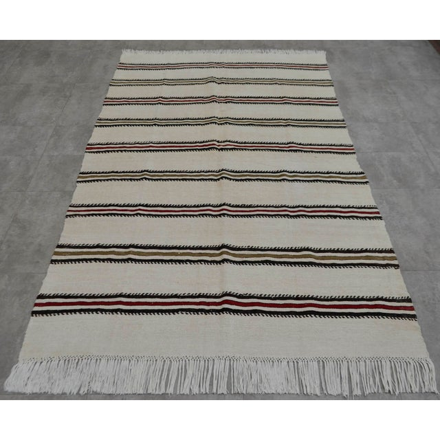Beige background brown and burgundy striped kilim rug, from Aegean Turkey. In excellent condition. Approximately 45-55...