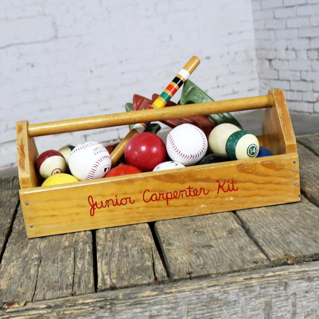 Fun and whimsical centerpiece or object d'art assemblage comprised of Junior Carpenter Kit toy tool box filled with...