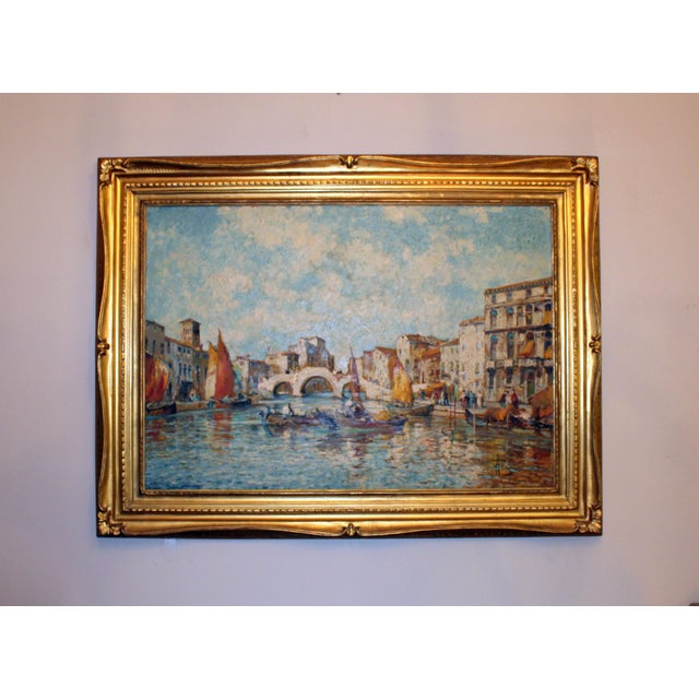 Bright blues stand out in this gorgeous painting depicting the canals of Venice. This would be a beautiful addition any room.