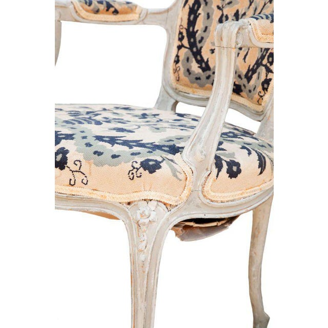 Charming pair of limed fauteuils with cabriole legs and blue petit point..