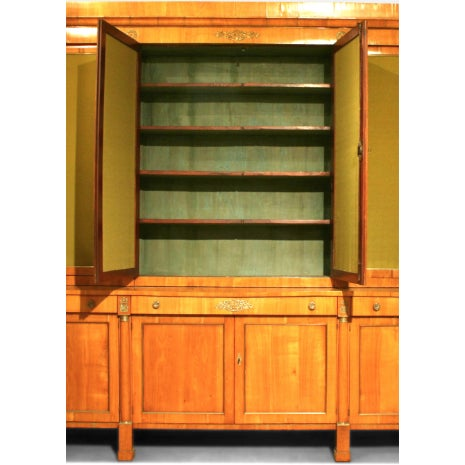 Large nineteenth century Austrian Biedermeier cherrywood and brass trimmed 12 door cabinet with column sides and fabric in...