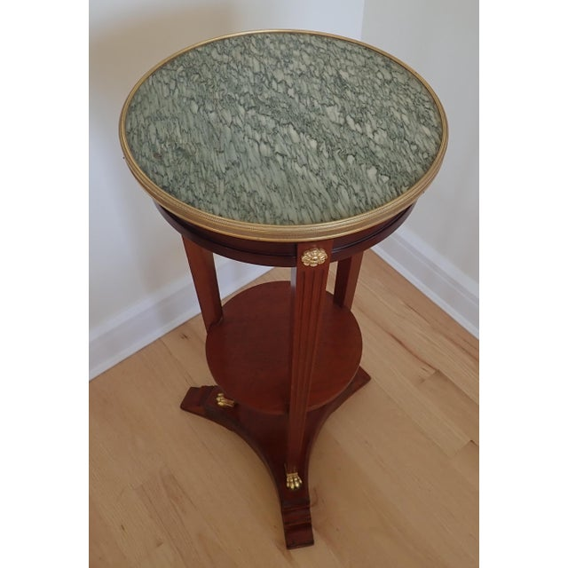 Mahogany pedestal. Marble top with Doré bronze gallery ring and feet . Height of shelf 15 1/2 inches. Triangular base...
