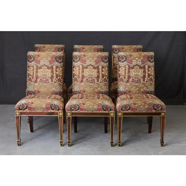 Set of 6 Regency style dining chairs with painted gilt elements and medallions. Some fading and loss to the fabric and...