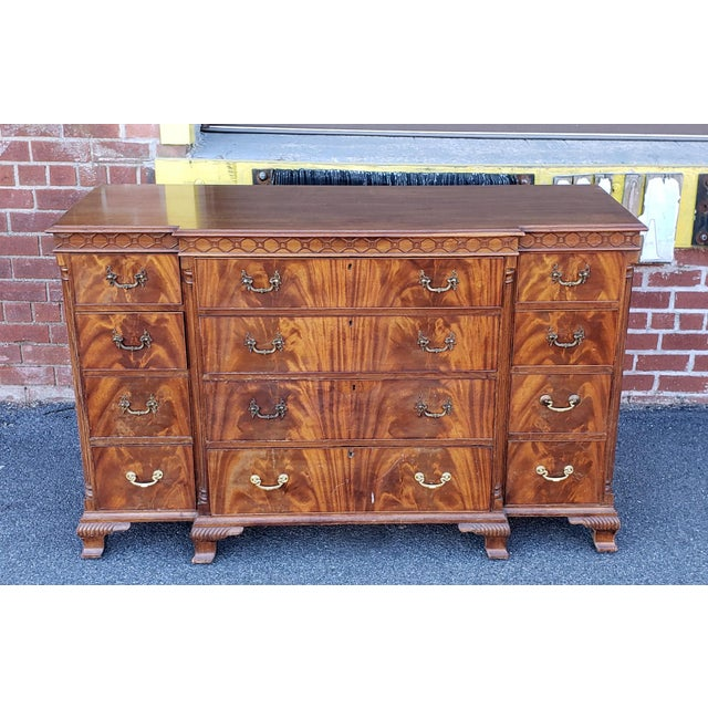This is a very nice looking and excellent quality antique flame mahogany bedroom dresser or hallway cabinet made by W&J....