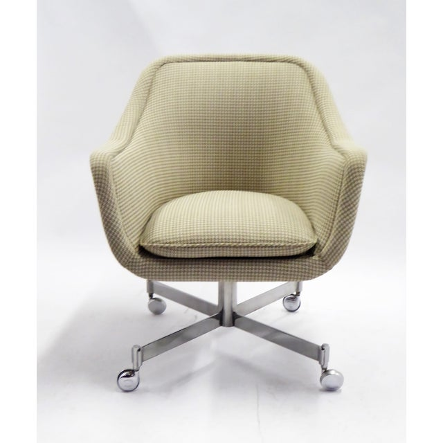 The Ward Bennett 1964 designed bumper desk chair, here reupholstered in a neutral beige Houndstooth fabric. This early...
