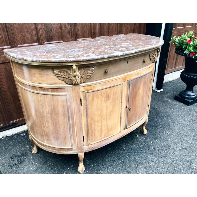 Limed demi lune sideboard with stunning swan carvings at each front corner. Ball and claw feet. Beautifully constructed....