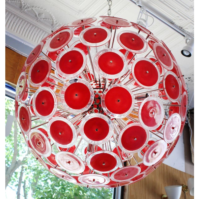 Spectacular modernist Vistosi disc sputnik chandelier. 95 round Murano coral red and clear glass disks and new chromed...