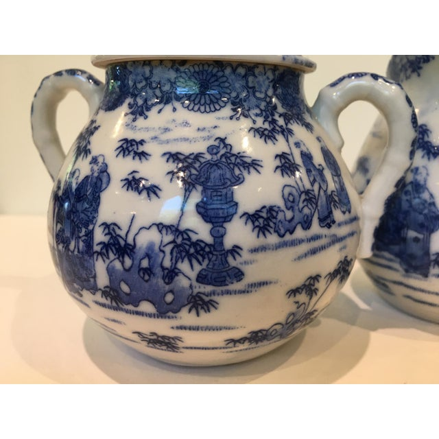 Charming vintage cream-and-sugar set decorated with intricate blue-and-white Chinese garden scenes. Perfect addition to a...