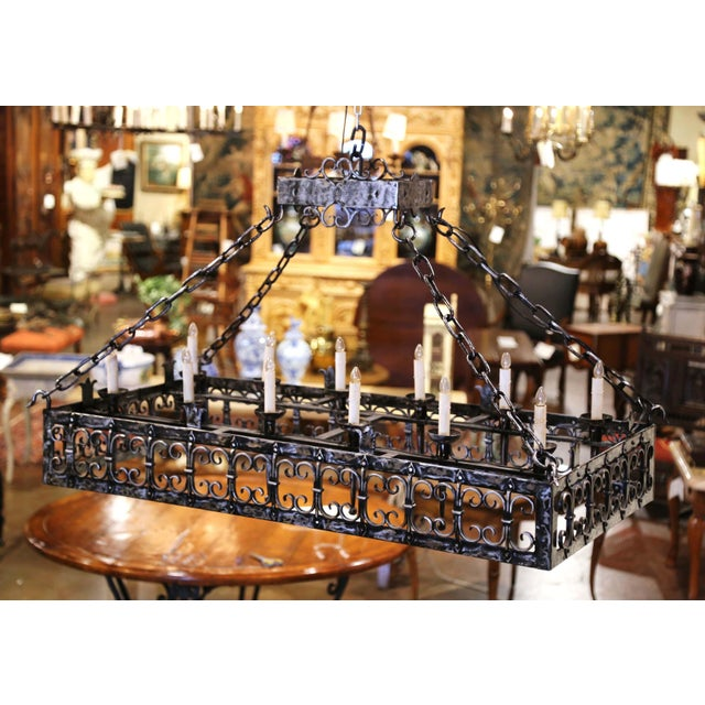 This elegant antique light fixture was forged in France, circa 1890. Rectangular in shape and over 4 feet long, the Gothic...